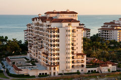 Massice Coastal Condo at Dusk Stock Photo