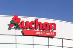 Auchan supermarket logo on a wall