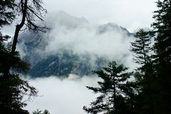 Wafts of mist at mountain massif Stock Photography