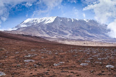 Massif of Kilimanjaro mountain and blue sky Stock Photo