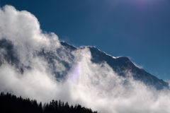 Massif Mont Blanc mountain ridge swept by strong winds partially Stock Photos