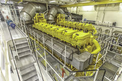Massive marine engine room. Tanker ship machinery room with two massive diesel engine Royalty Free Stock Photos
