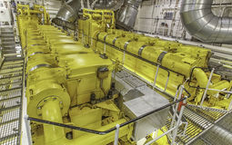 Massive marine engine room. Tanker machinery room with two massive diesel engine stock photos