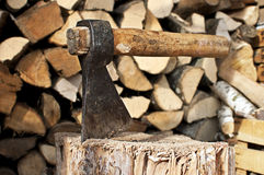 Massive ax stuck in a beech stub Stock Images