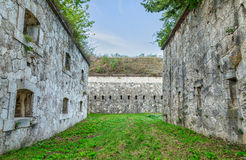 Massive bastions with gun ports . The massive bastions with gun ports and a passage between the inner and outer walls Royalty Free Stock Images