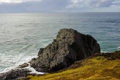 Massive black rock at seashore at Port Macquarie Australia Stock Photo