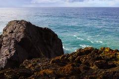 Massive black rock at seashore at Port Macquarie Australia Royalty Free Stock Images