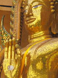 Massive Buddha Statue. Massive golden Buddha in sitting pose with open palm in Kanchanaburi, Thailand Stock Photography