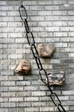 Massive chain against brick wall. Royalty Free Stock Images
