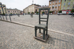 Massive chair on cobblestone street Stock Photography
