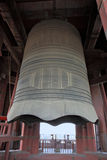 Massive Chinese Bell. Huge Chinese bronze bell hanging atop tower stock photo