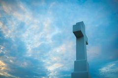 Christian cross in the blue sky stock photography