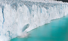 A massive chunk of ice falls off the Perito Moreno Glacier - Argentina Royalty Free Stock Photos