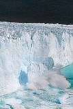 A massive chunk of ice falls off the Perito Moreno Glacier - Argentina Stock Photo