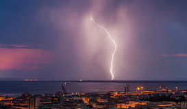 Massive cloud to ground lightning bolts hitting Stock Photography
