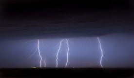 Massive cloud to ground lightning bolts hitting Royalty Free Stock Photo