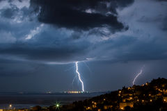 Massive cloud to ground lightning bolts hitting Royalty Free Stock Photos