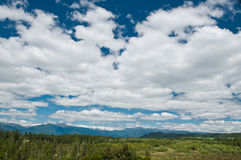 Massive cloudy sky above the wilderness Stock Image