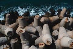 Massive concrete tetrapods form a breakwater. Massive concrete interlocking tetrapods form a breakwater Stock Image