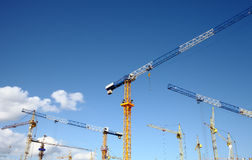 Massive construction with a plurality of tower cranes Stock Photography
