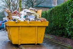 Massive container full of bulky waste, pile of garbage, recycling concept royalty free stock image