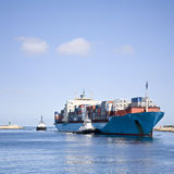 Massive Container Ship Entering River Mouth royalty free stock photo