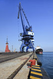 Massive crane in Port of Dalian. DALIAN-CHINA-NOV. 3, 2012. Port of Dalian on Nov. 3, 2012 in Dalian. Lies in Liaoning Province and is the most northern ice-free Stock Photos
