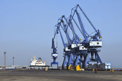 Massive cranes in Port of Dalian. DALIAN-CHINA-NOV. 3, 2012. Port of Dalian on Nov. 3, 2012 in Dalian. Lies in Liaoning Province and is the most northern ice Royalty Free Stock Photos