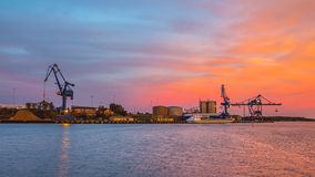 Massive cranes during sunset Royalty Free Stock Image