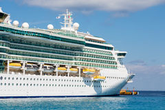 Massive Cruise Ship On Blue Water Stock Photography