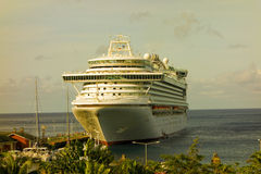 A massive cruise ship calling at kingstown, st. vincent. A huge passenger ship secured at a cruise ship facility in the windward islands Stock Photography