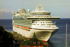 A massive cruise ship docked at kingstown, st, vincent Royalty Free Stock Photography