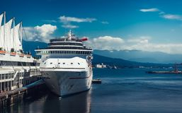 Vancouver / Canada - July 28.2006: Massive Cruise Ship docked by the pier. stock images