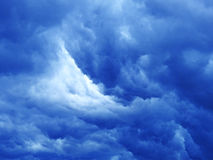 Massive dark blue clouds. Royalty Free Stock Photography