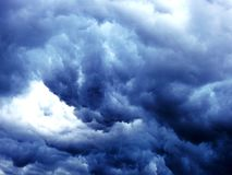Massive dark blue clouds. Royalty Free Stock Image