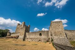 Massive walls of the Rochester castle. Massive defensive walls and high towers of the ruins of the 12th-century Rochester Castle, Kent, South East England stock photos