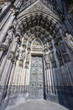 Massive doors into Cologne Cathedral. Pure gothic style and amazing architecture in Cologne, Germany stock images
