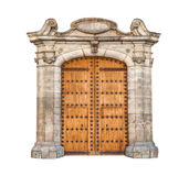 Massive doorway isolated on white background. Wooden double doors with iron details. Beautiful stone arch designed in gothic style. Massive doorway isolated on Stock Images