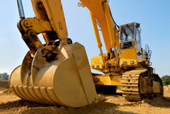 Massive earth digger. Huge excavator on a sunny day with blue sky royalty free stock image