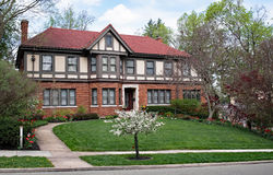 Massive English Tudor Home with Spring Landscape Stock Photos