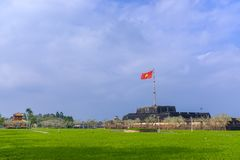 Flagpole by the Hue Citadel. A massive flagpole with Vietnamese flag by the entrance to the Citadel in downtown Hue, Vietnam royalty free stock photo