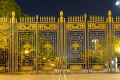 Massive gates, fence with spiky, in the evening. night stock photo