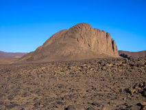 Massive geological rock in Hoggar desert, Algeria Stock Photos