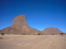 Massive geological rock in Hoggar desert, Algeria Royalty Free Stock Images