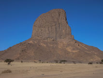 Massive geological rock in Hoggar desert, Algeria Royalty Free Stock Photography