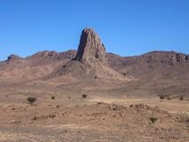 Massive geological rock in Hoggar desert, Algeria Stock Image