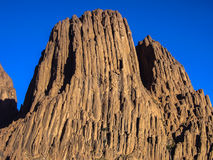 Massive geological rock in Hoggar desert, Algeria Stock Images