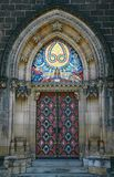 Massive gothic portal. With coloured mosaic in Prague Royalty Free Stock Image