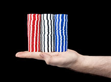 Massive hand of chips. A hand holding very large stacks of blue, red and white poker chips Royalty Free Stock Images