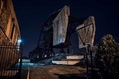 Massive industrial Bascule railroad train bridge at night. Massive industrial Chicago Bascule railroad train bridge at night stock image
